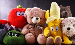 Group of stuffed animal toys in a children's room