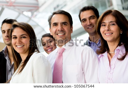 Group of successful business people lat the office