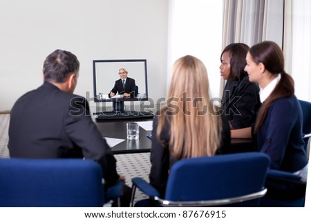 Group of successful young businesspeople at a video conference in the office
