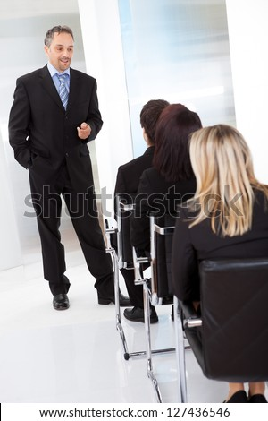 Group of successfull business people at the lecture
