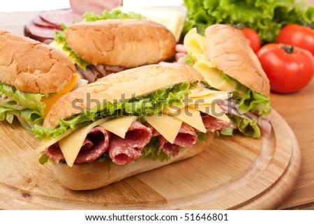 group of tasty ham, salami, turkey and beef sandwiches