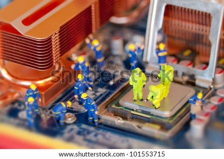 Group of Technicians repairing computer