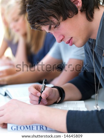 stock photo : Group of teen boys and girls writing notes