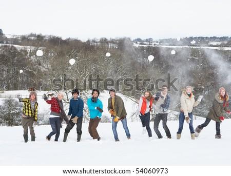 Group Of Teenage Friends Having Fun In Snowy Landscape