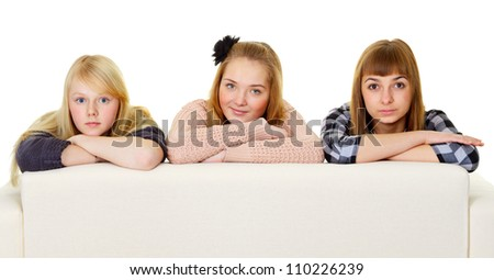 Group of teenage friends on the couch isolated on white background