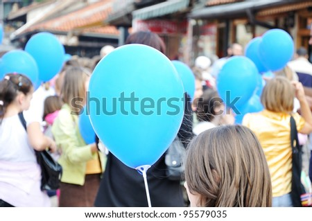 Group of teenage kids with baloons - stock photo