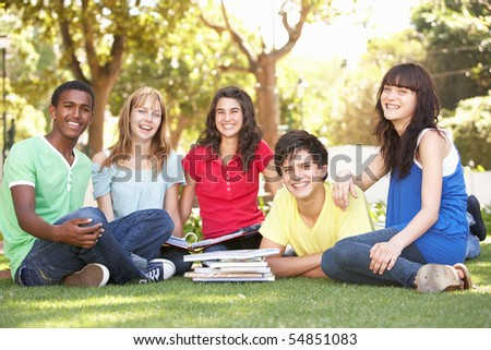 Group Of Teenage Students Chatting Together In Park