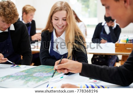 Group Of Teenage Students Studying Together In Art Class