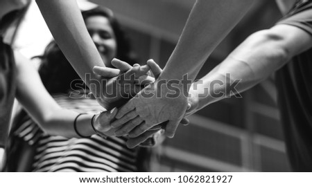 Group of teenager friends on a basketball court teamwork and togetherness concept #1062821927