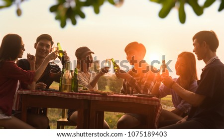 Group of 6 teenager have dinner party celebrating at sunset with beautiful landscape background #1075189403