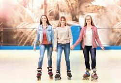Group of teenagers at roller skating rink