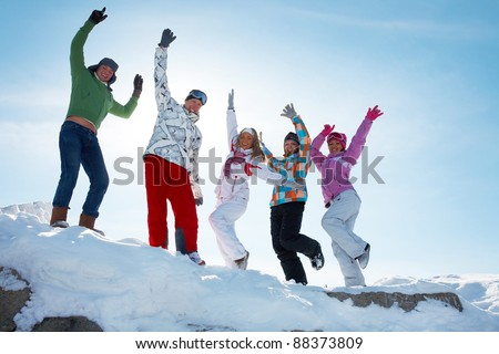 Group of  teenagers dansing together in wintertime