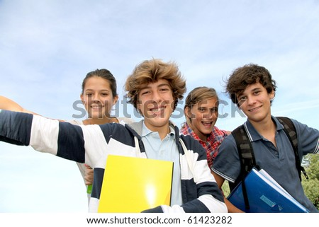 Group of teenagers studying outside the class - stock photo