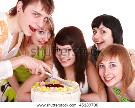 Group of teenagers with cake celebrate happy birthday. Isolated.