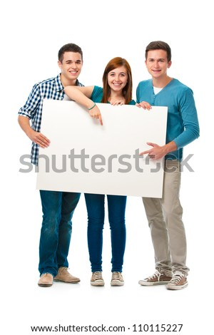 Group of teens standing together and holding a blank board