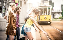 Group of teens waiting the tram