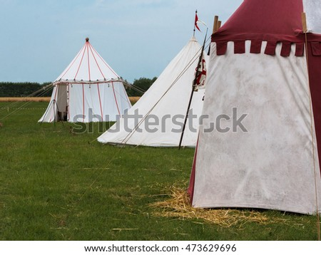 Group of Tents on Meadow set up for Medieval Event Reconstruction #473629696