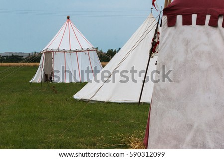 Group of Tents on Meadow set up for Medieval Event Reconstruction #590312099