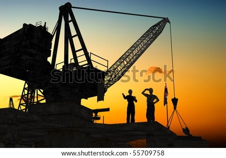 Group of the builders on the building crane