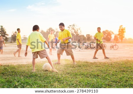 Group of the kids (boys) are playing soccer football for exercise in the sunshine day. - Shutterstock ID 278439110