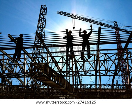 Group of the workers on a background of the sky - stock photo
