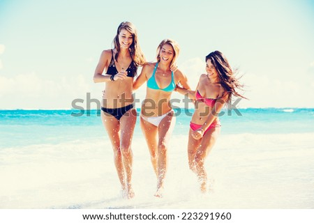 Group of Three Beautiful Attractive Young Women Walking on the Beach #223291960