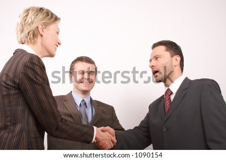 Group of  three business people - man and woman hand shake