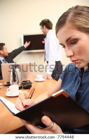 Group of three business people working in the office.woman in focus