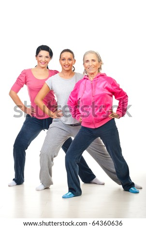 Group of three cheerful women doing fitness over white background