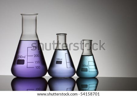 group of three conical flasks containing liquid shiny