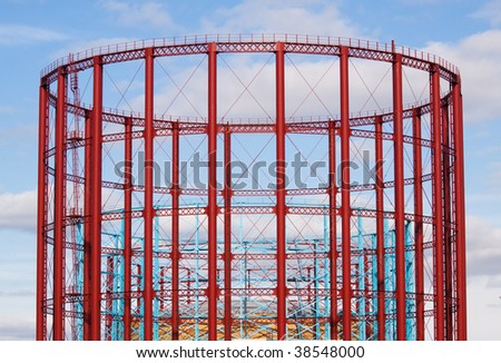 Group of three English, restored gasholders in the sunlight