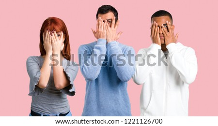 Group of three friends covering eyes by hands #1221126700