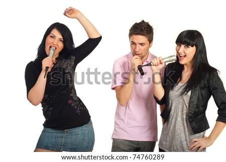 Group of three friends singing with microphones isolated on white background
