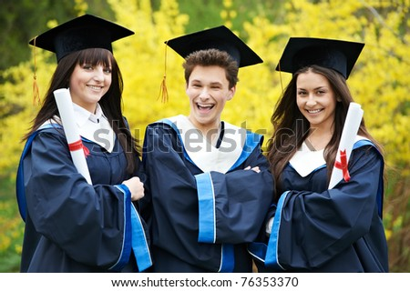 group of three graduation students in the park ? cheerful and happy