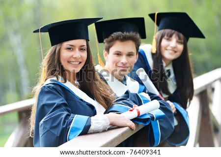 group of three graduation students in the park cheerful and happy