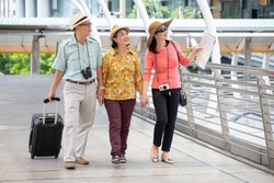 group of three happy asian Senior  tourists walking in urban city outdoors.  old man Travellers lifestyle  . elderly women vacation . ageing society concept. pensioner traveling . mature