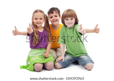 Group of three kids giving thumbs up sign - isolated