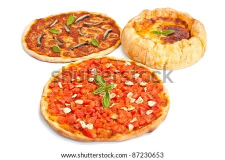 group of three pizzas: alla marinara with tomatoes and garlic, alla napoletana with anchovies, mozzarella and tomato sauce and chicago-style deep- dish stuffed pizza
