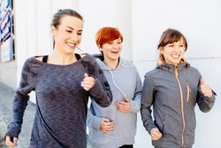 Group of three sports woman jogging outside. Healthy lifestyle and sport concepts