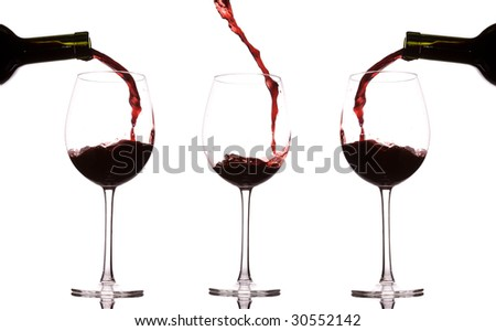 Group of three wine glasses with pouring and splashing liquid