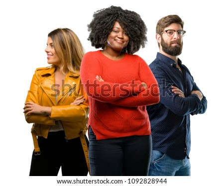 Group of three young men and women with crossed arms confident and happy with a big natural smile laughing