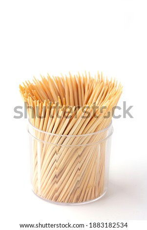 Group of Toothpick in container isolated on white background,  Toothpick is a piece of wooden, small, short stick and peaked, It's device for removing food particles or dirt between teeth. Tableware. Foto stock ©