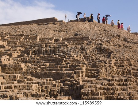 Group of tourists decends the Huaca Pucllana pyramid