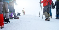Group of tourists with hiking equipment for winter expedition