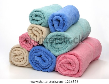 Group of towels like a pyramid. Soft colors over white background