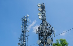 Group of towers for telecommunications, television broadcast, cellphone on mountain peak. Telecommunication center. Electromagnetic and environmental pollution