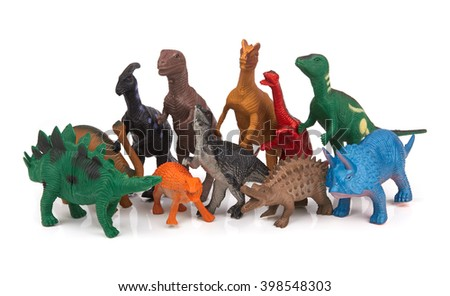 Group of toy dinosaurs on white background #398548303