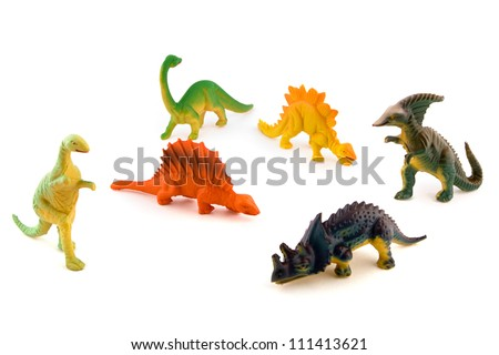 Group of toy plastic dinosaurs over white #111413621