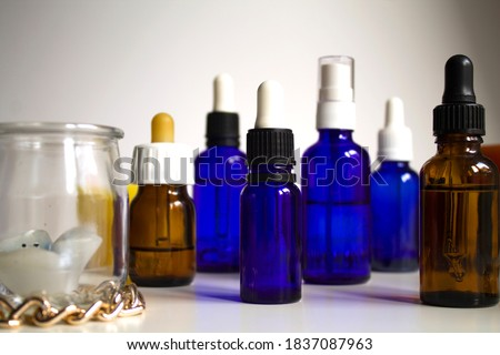 group of transparent vials and pipettes with white background Stockfoto ©