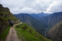 Group of Trekkers admiring the Andes whilst on the way to the Sun Gate on the Inka Trail before heading down to Machu Picchu